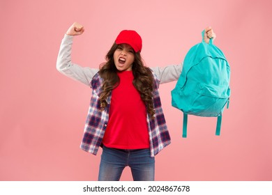 Powerful kid. Carrying things in backpack. Learn how fit backpack correctly. Girl little fashionable kid carry backpack. Useful fashion accessory. Schoolgirl red cap long hair with school backpack