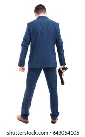 Powerful killer with a gun standing with back at the camera on white background