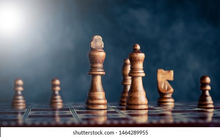 Powerful king and queen pieces on chess board battlefield