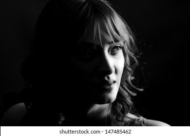 powerful low key image of a beautiful woman in monochrome