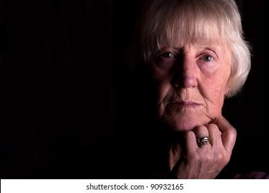 powerful low key portrait of an elderly beautiful woman