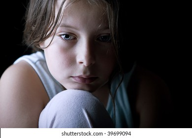 Powerful Low Key Shot of a Young Child Looking Sad