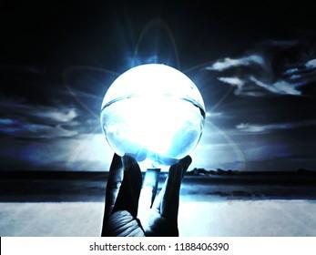 Powerful magic sphere,Fortune teller,mind power concept, light flare effect