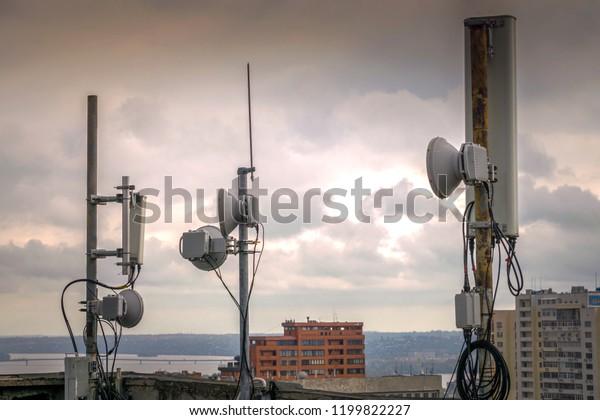 Powerful Mobile Base Station Antennas Background Stock Photo