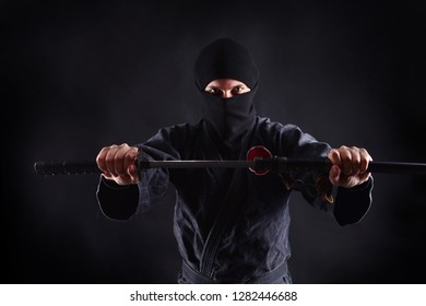 Powerful ninja portrait with katana