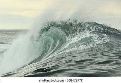 Powerful ocean wave breaking. Wave on the surface of the ocean. Wave breaks on a shallow bank. Natural background