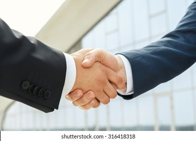 Powerful partnership supported by a handshake outdoors