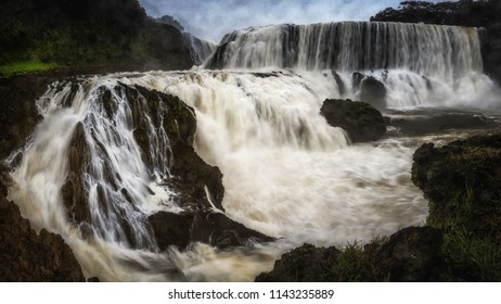 The powerful of Sae pong lai waterfall in southern Laos