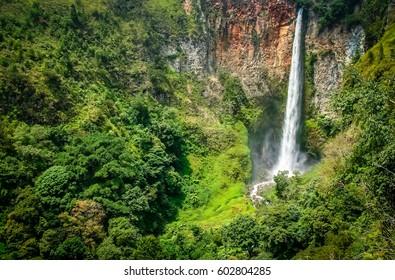 Powerful Sipisu Pisu waterfall in northern Sumatra Indonesia