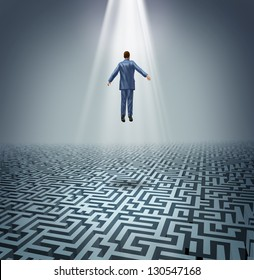 Powerful solutions with a businessman levitating above a maze or labyrinth as a business concept of leadership and conquering challenges and obstacles with a man rising above to find the answers.