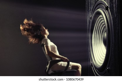 The powerful sound set back a young woman. - Shutterstock ID 1080670439