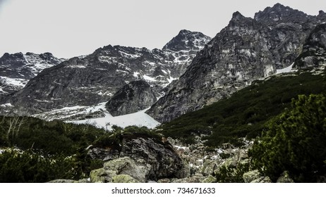 Powerful Tatra mountains with green grass and snow, Poland journey