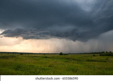Powerful thunderstorm over the green field