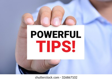 POWERFUL TIPS!, message on the card shown by a man