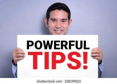 POWERFUL TIPS! message on white cardboard held by smiling man