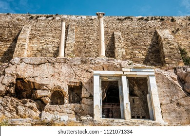 Powerful wall of the Acropolis hill in Athens, Greece. The ancient Greek Acropolis is the main tourist attraction of Athens. Panorama of the ruins and stronghold fortification on the Acropolis slope.