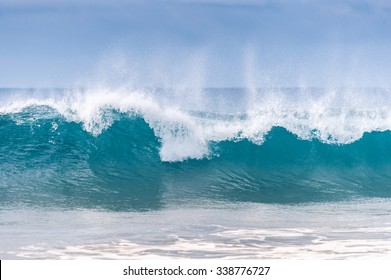 Powerful wave breaks along the shore