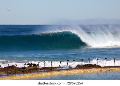 A powerful wave breaks towards newcastle ocean baths. Newcastle is Australia's second oldest city with surf beaches walking distance from the CBD area.