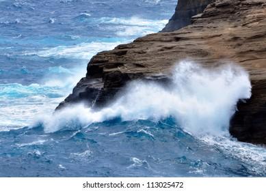 Powerful waves crashing against the rocks