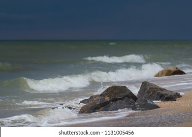 Powerful Waves crushing on a rocky beach