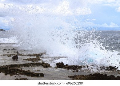 Powerful Waves Hit the Cliff and Produces Splashes of Seawater
