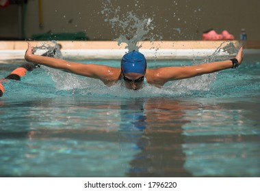 Powerful woman swimmer doing butterfly stroke