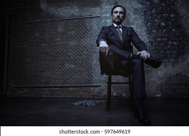 Powerful world class criminal sitting on his throne