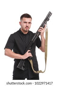 Powerful young man with a rifle isolated on white