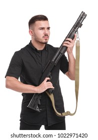Powerful young man with a rifle isolated on white. White background