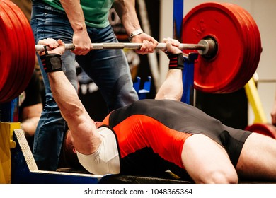 powerlifter bench press barbell competition in powerlifting