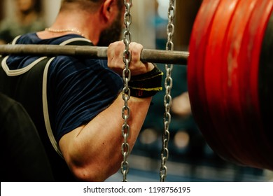 powerlifting back male athlete squat with barbell