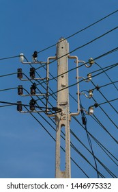 Powerlines and isolators at a pole in front of blue sky