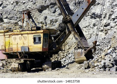 A power-shovel works in a career