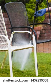 Power-washing/pressure-cleaning garden objects or furniture