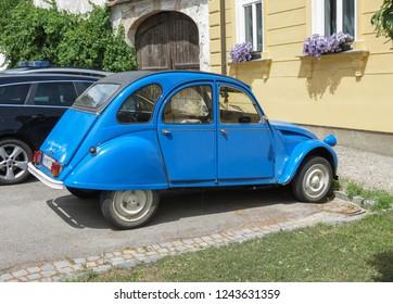 POYSDORF, AUSTRIA - CIRCA JUNE 2018: blue Citroen 2CV car parked in a street of the city centre