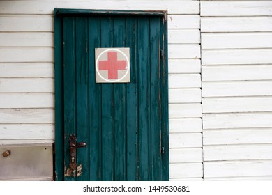 Poysdorf, Austria - July, 07, 2019: First aid centre. Door with red cross. Small medical centre for first aid.