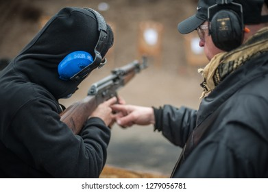Pozarevac, Serbia - December 21-24, 2018: Instructor Zeljko Vujicic teaches his students on shooting range GROM, how to safely use Kalashnikov rifle on KAPAP BASIC FIREARMS SAFETY AND GUN USE SEMINAR