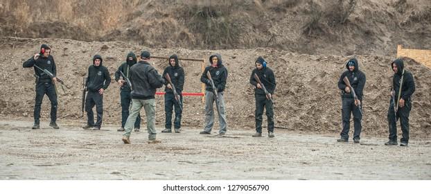 Pozarevac, Serbia - December 21-24, 2018: Instructor Zeljko Vujicic teaches large group of students on shooting range GROM to use Kalashnikov rifle on KAPAP BASIC FIREARMS SAFETY AND GUN USE SEMINAR