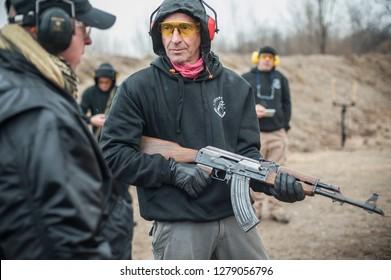 Pozarevac, Serbia - December 21-24, 2018: Instructor Zeljko Vujicic teaches his students on shooting range GROM, how to safely use Kalashnikov rifle on KAPAP BASIC FIREARMS SAFETY AND GUN USE SEMINAR