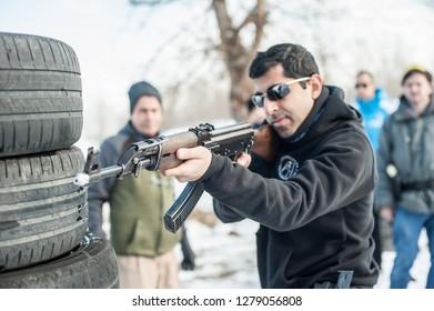 Pozarevac, Serbia - December 21-24, 2018: Instructor Avi Nardia teaches large group of students on shooting range GROM, how to use Kalashnikov rifle on KAPAP BASIC FIREARMS SAFETY AND GUN USE SEMINAR