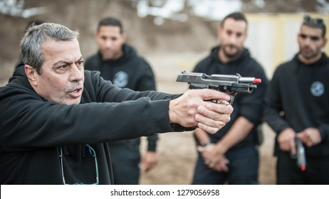 Pozarevac, Serbia - December 21-24, 2018: Kapap Instructor Avi Nardia teaches large group of students on the shooting range GROM, how safely use gun on KAPAP BASIC FIREARMS SAFETY AND GUN USE SEMINAR