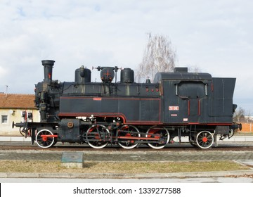 Pozega, Croatia - March 02, 2019: Street view. Steam locomotive monument. Side view.