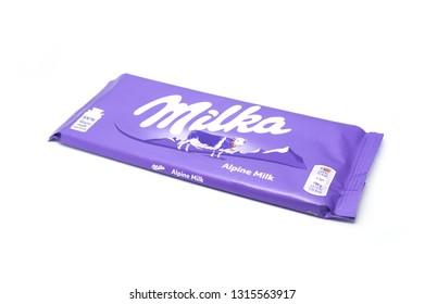 Pozega,Croatia- February 17, 2019: Milka chocolate Alpine milk, 100g