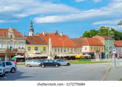 Pozega,Croatia- July 14, 2018: The Holy Trinity Square in Pozega, sunset, Slavonia region