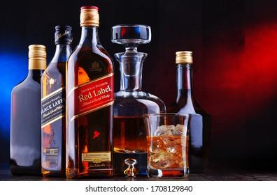 POZNAN, POL - APR 16, 2020: Bottles of Johnnie Walker Red Label and Black Label among other hard liquor drinks