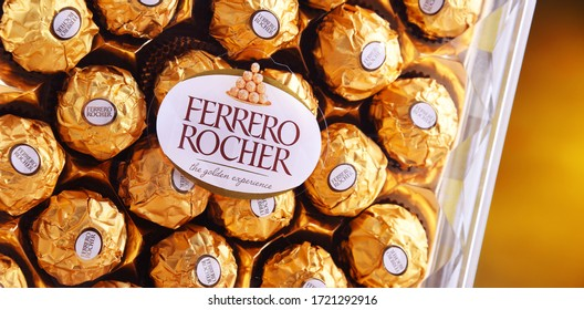 POZNAN, POL - APR 16, 2020: Ferrero Rocher premium chocolate sweets produced by the Italian chocolatier Ferrero SpA., sold in over 40 countries in amount of about 3.6 billion a year