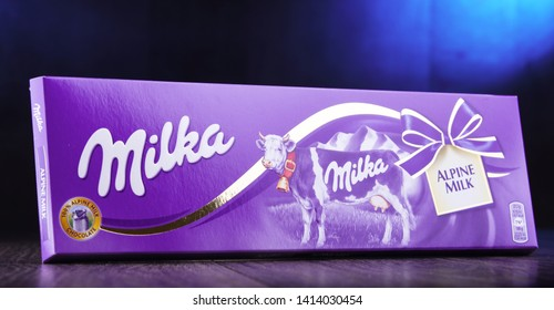 POZNAN, POL - APR 24, 2014: Milka chocolate, a brand of chocolate confection which originated in Switzerland in 1825 and since 1990 has been manufactured by the Mondelez Int. (formerly Kraft Foods)