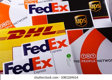 POZNAN, POL - APR 26, 2018: Envelopes of 4 popular courier services in the world: UPS, FedEx, DHL and TNT