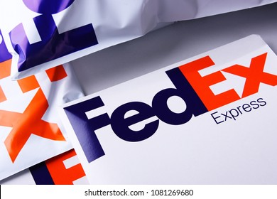 POZNAN, POL - APR 26, 2018: Envelopes and parcels of FedEx, an American multinational courier delivery services company headquartered in Memphis, Tennessee.