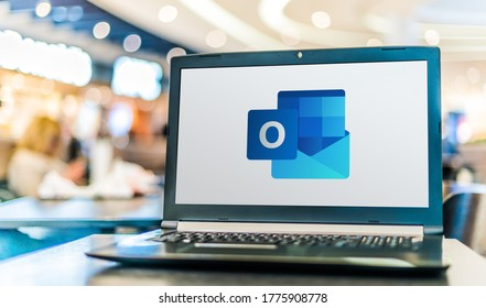 POZNAN, POL - APR 28, 2020: Laptop computer displaying logo of Microsoft Outlook program, part of the Office family software and services developed by Microsoft